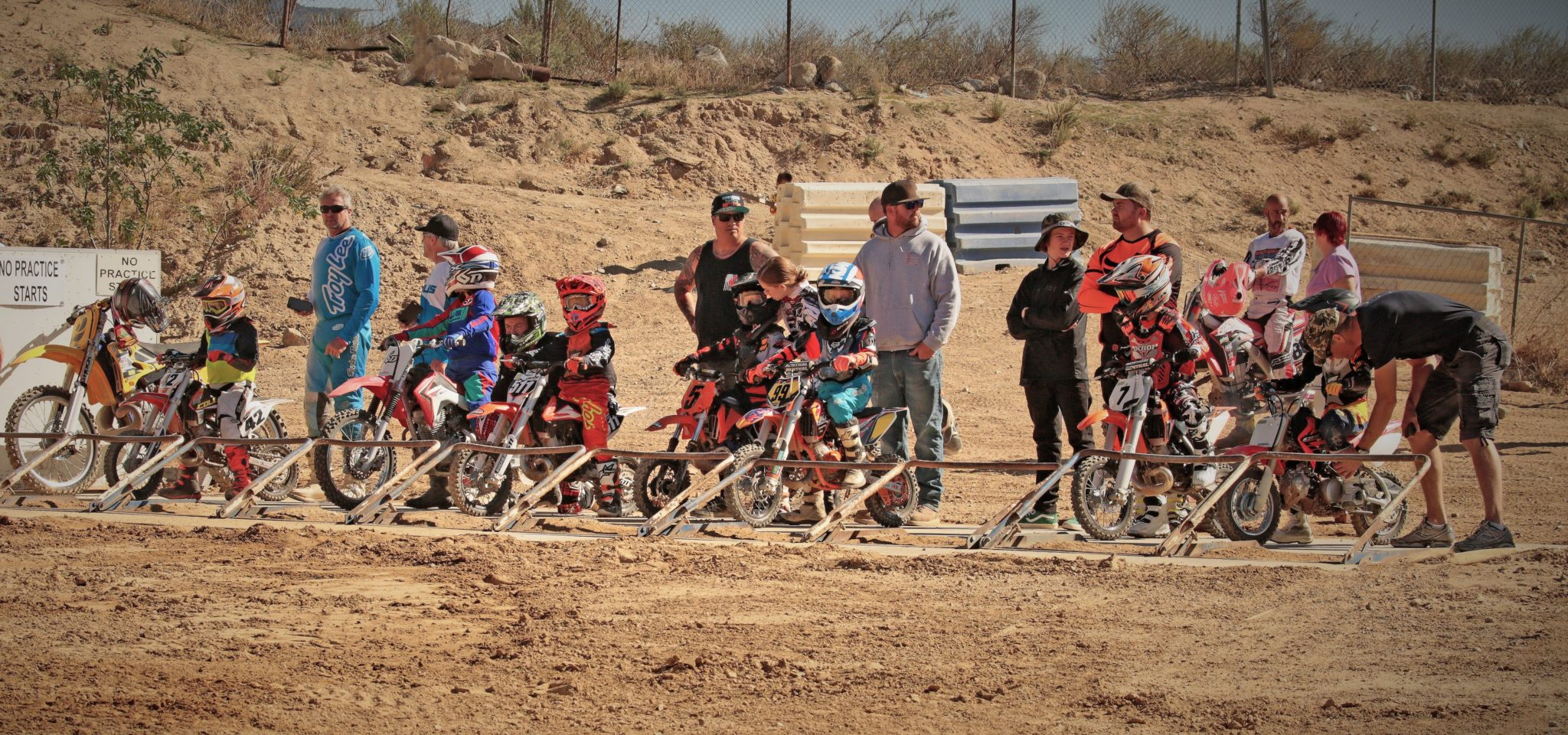 Peewee class racers and parents on the starting gate.